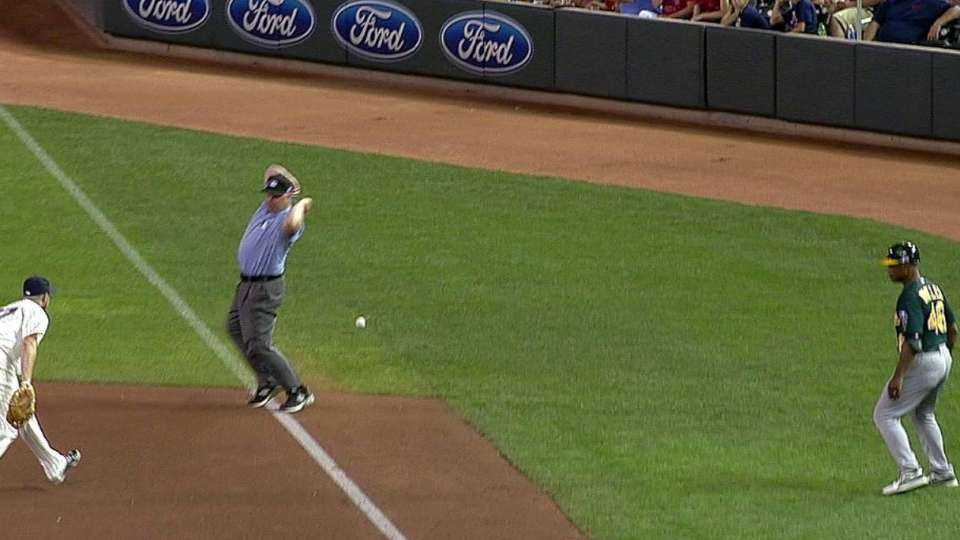 Lowrie's foul ball overturned