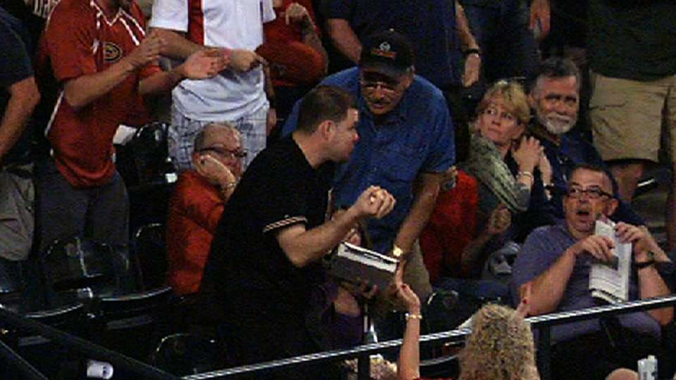 Fan saves pizza, catches foul