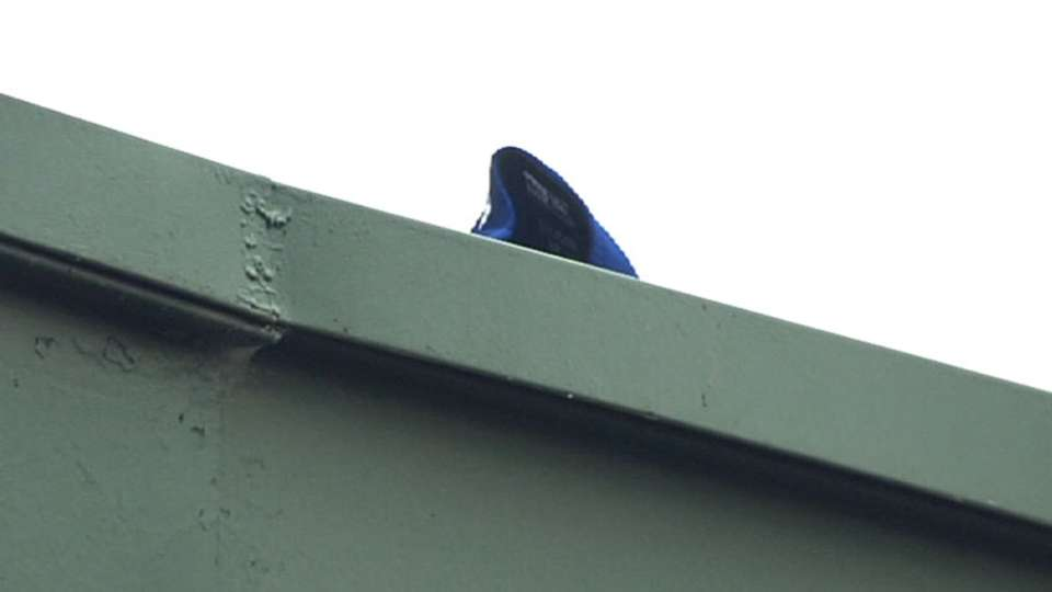 Cubs cap on Wrigley roof