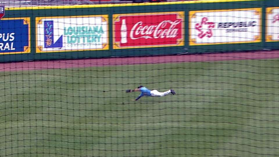 Jones dives for the out