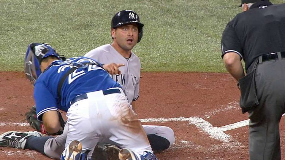 Umpires review play at the plate