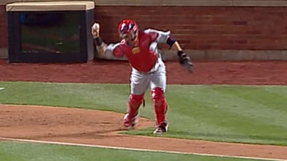 Molina throws out C. Young