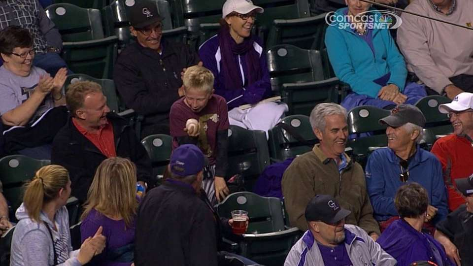 Young fan excited to get a ball