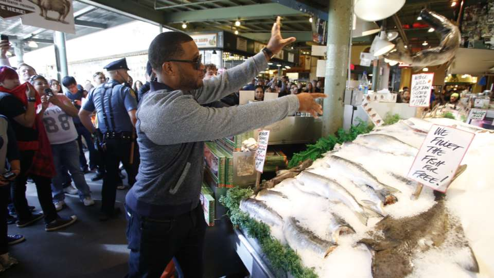 Cano Tosses Fish at Pike Place