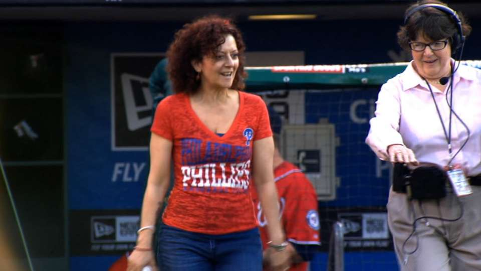 Hansberry throws first pitch