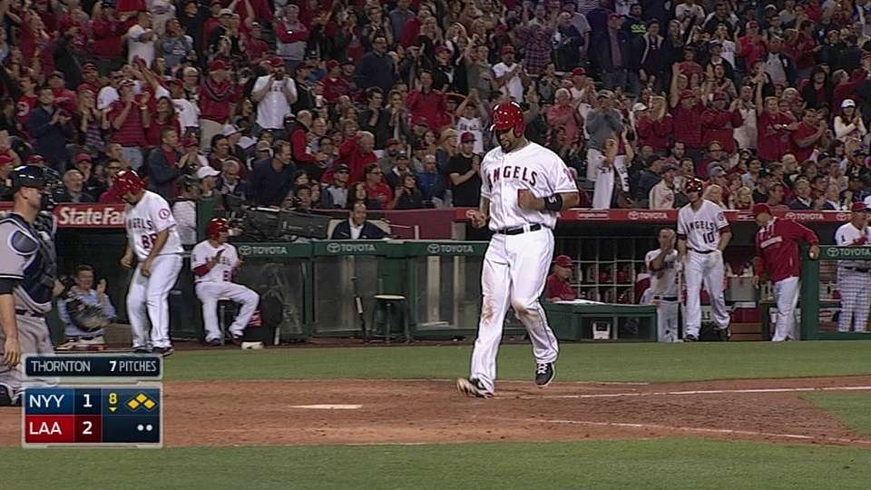 Pujols scores on walk