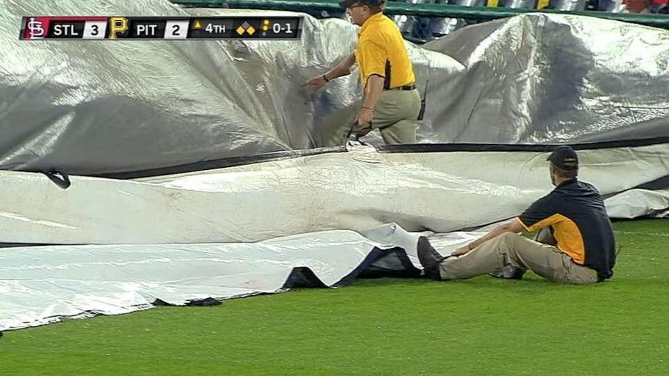 Grounds crew battles tarp