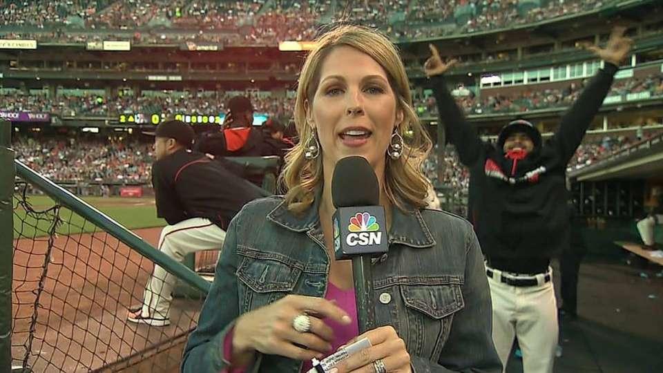 Romo photobombs reporter
