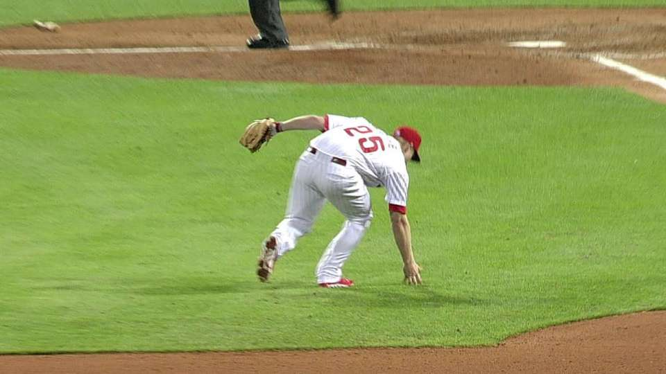 Asche's barehanded play