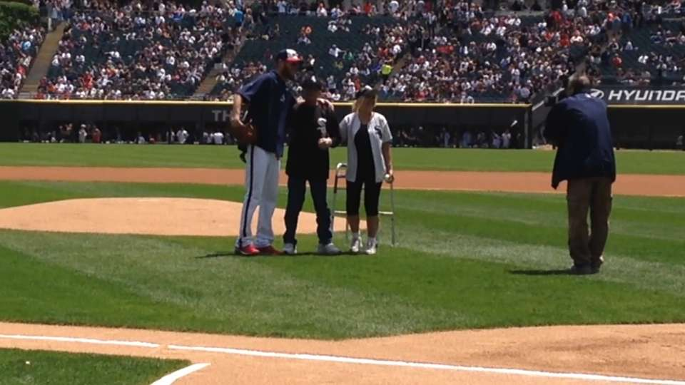 Norb Zook throws first pitch
