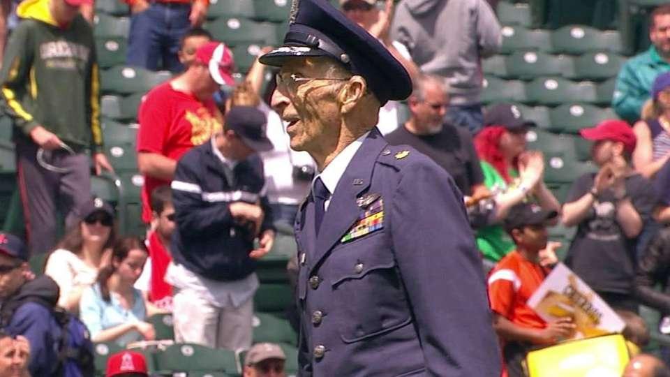 Veteran tosses first pitch