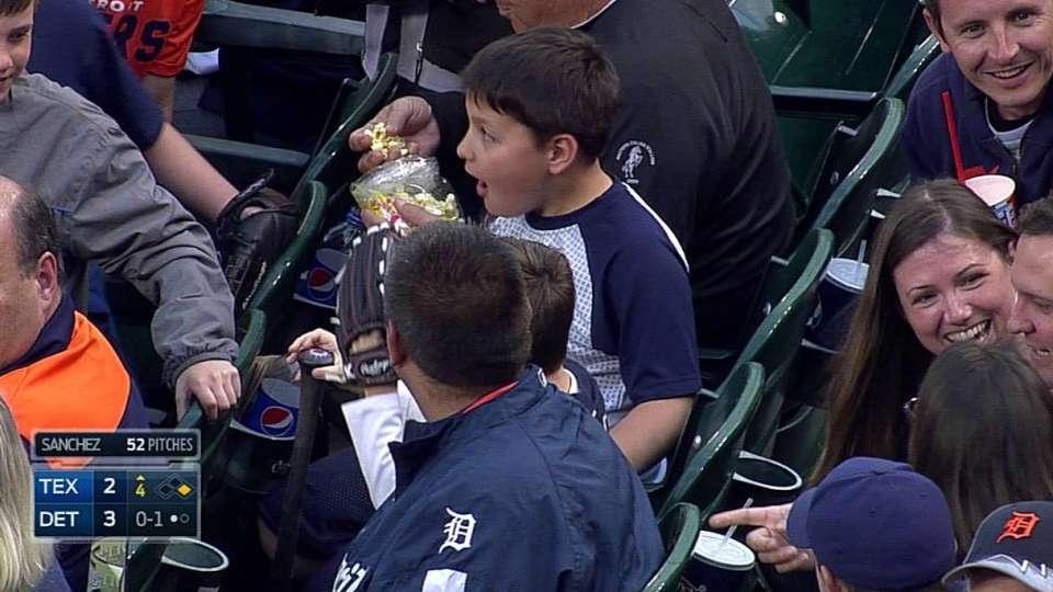 Two kids catch bat