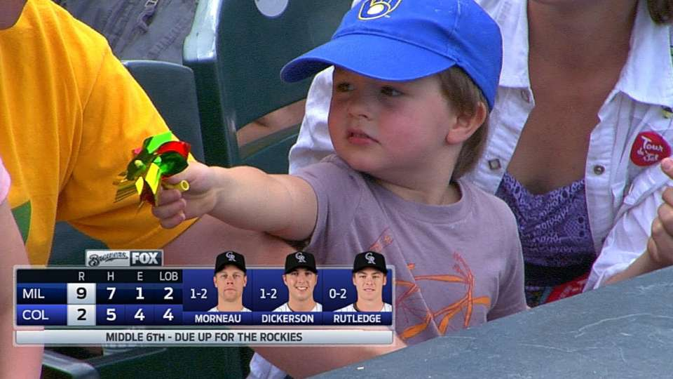 Young fan receives ball