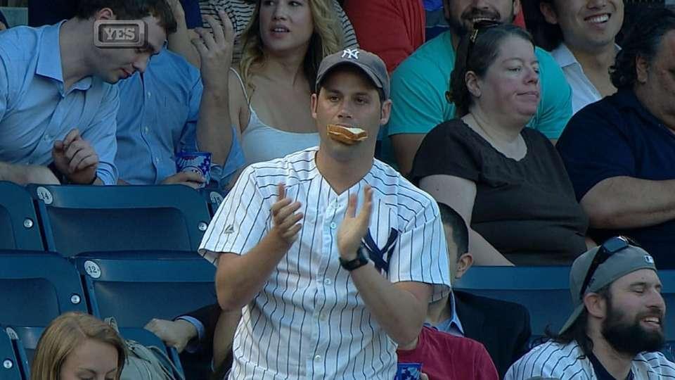 Fan takes break from sandwich