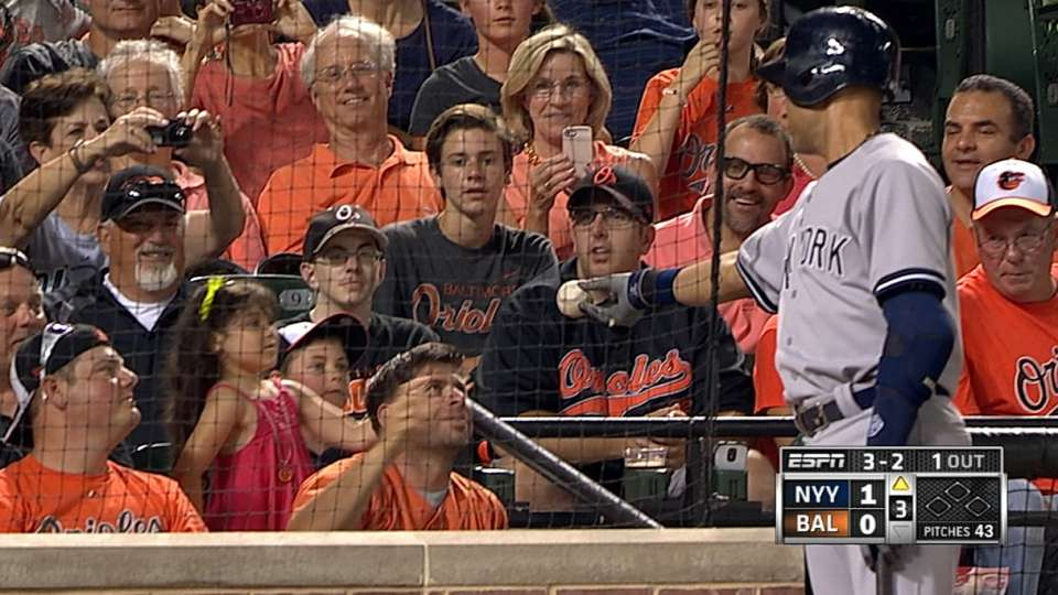 Jeter gives ball to young fan