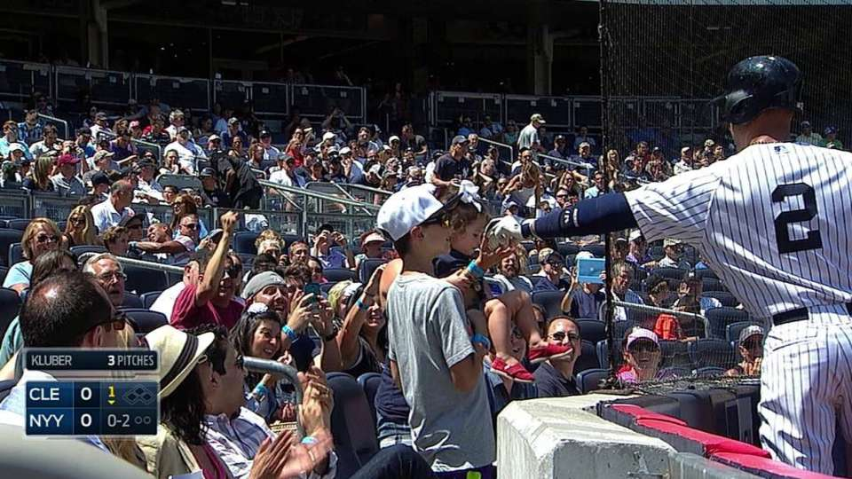 Jeter gifts ball to young fan