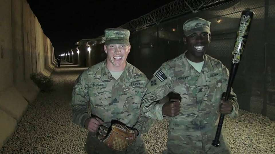 Troops cheer on the Yanks