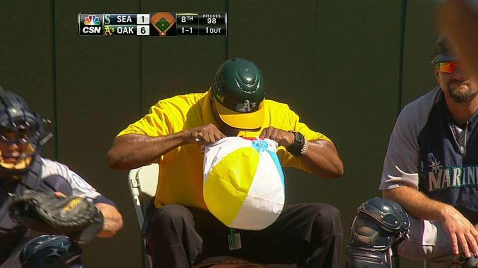 Security guard grabs beach ball