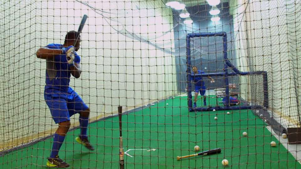 Puig works in the cage