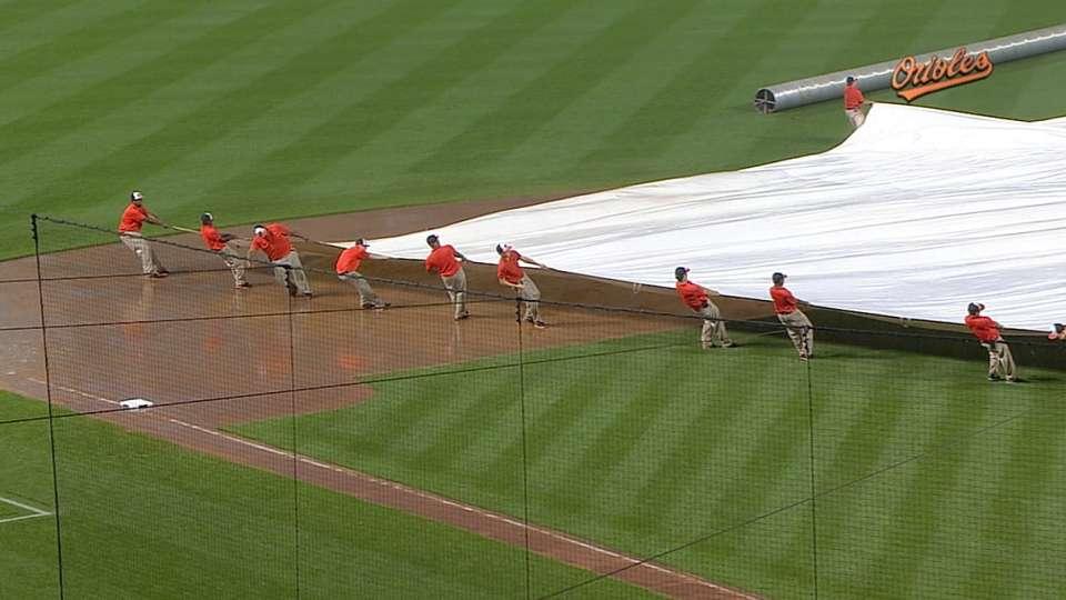 Grounds crew struggles with tarp