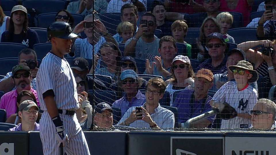 Jeter tosses ball to young fan