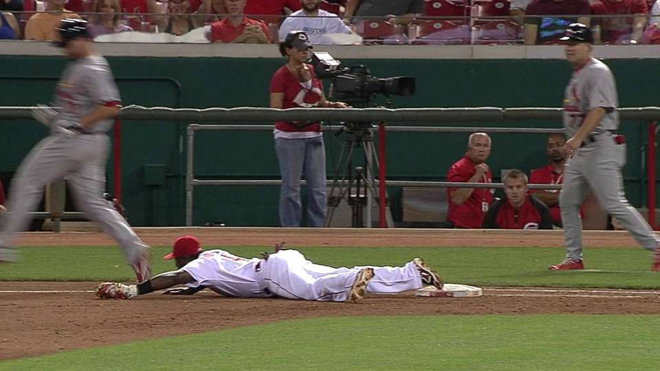 Reds turn a tough double play
