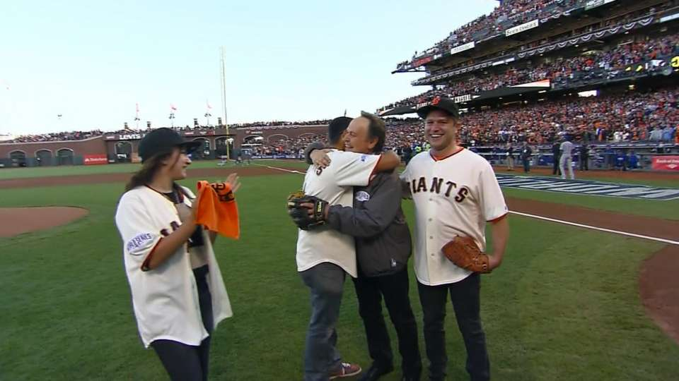Williams' kids throw first pitch