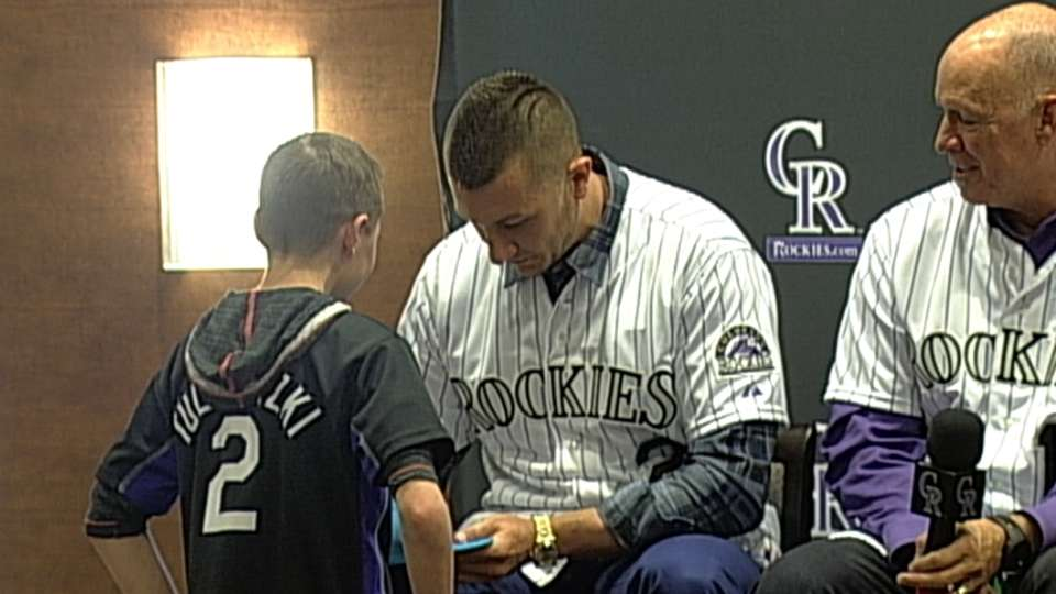 Tulo signs a young fan's cap