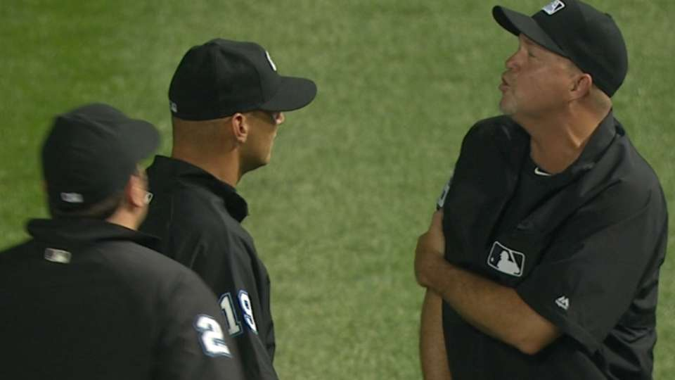 Umpire hit by warmup pitch
