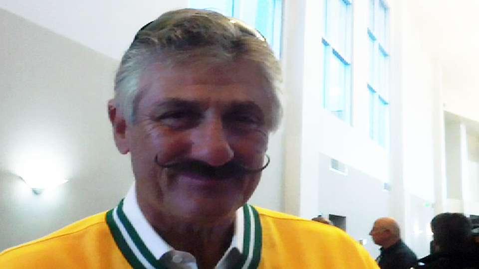 Fingers on handlebar moustache