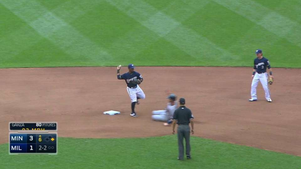 Brewers challenge play at first