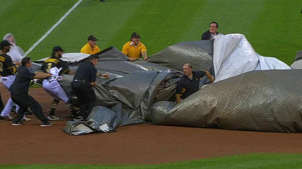 Pirates help out grounds crew