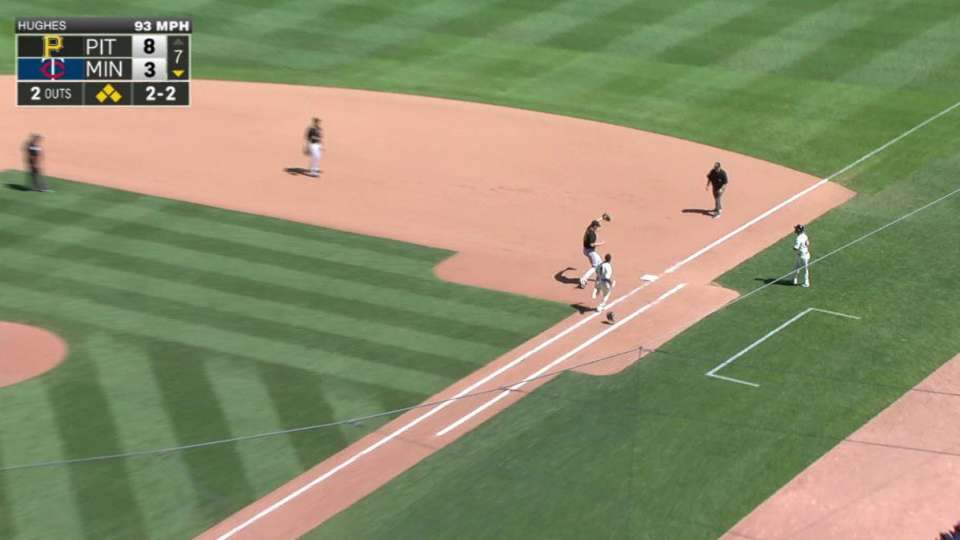 Hughes escapes bases-loaded jam