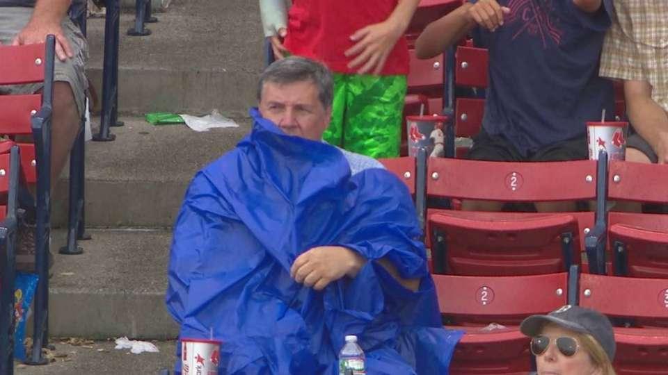 Fan struggles to put on poncho