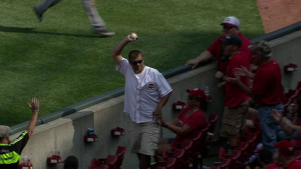 Fan makes catch, gives ball away