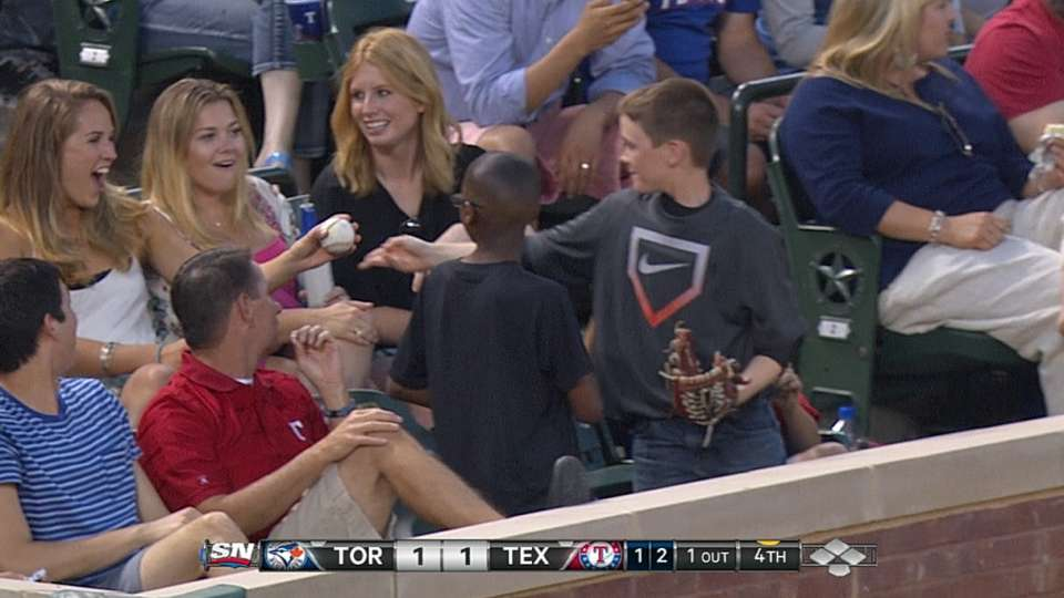 Young fan does foul ball switch