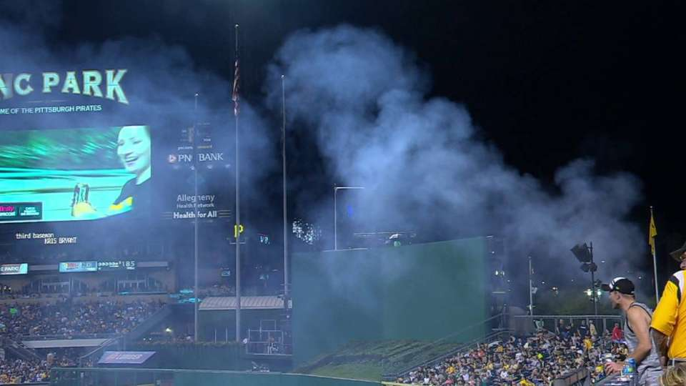 Smoke rises over outfield