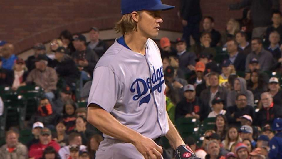 Greinke strikes out seven