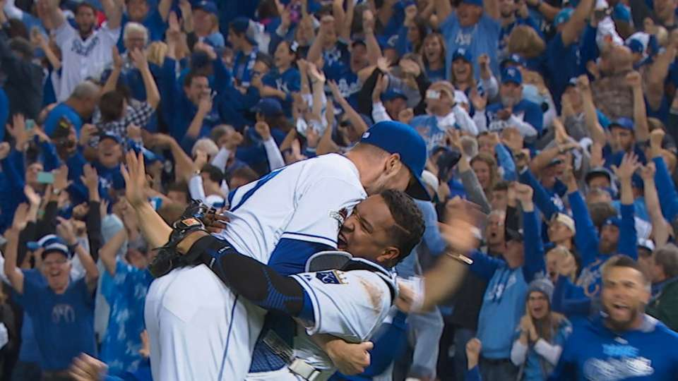 Royals survive wild 9th, advance