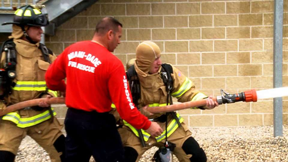 Marlins visit firemen