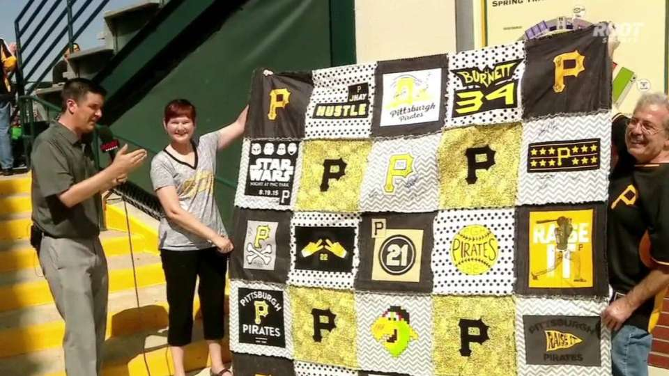 Fan displays her T-shirt quilt