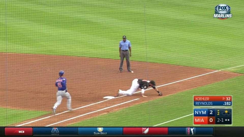 Umpire avoids ball, run scores