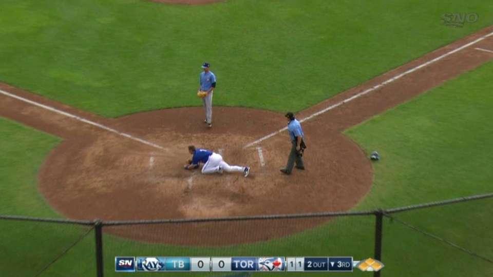 Burns scores on wild pitch