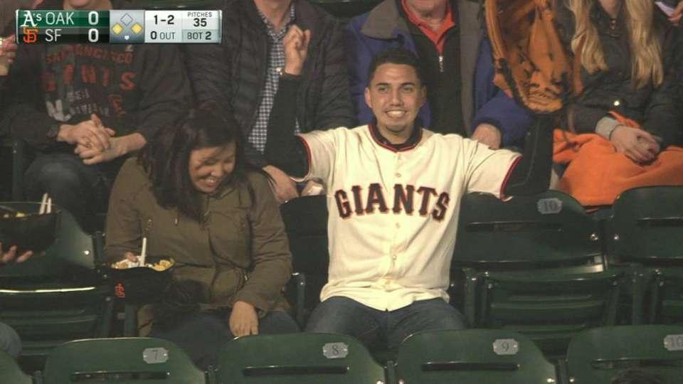 Fan uses huge glove