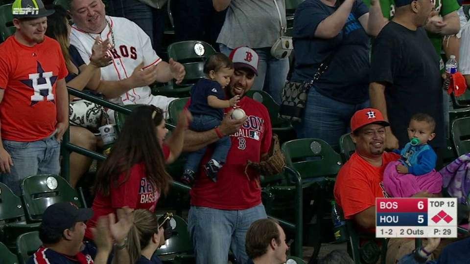 Fan holding kid makes catch