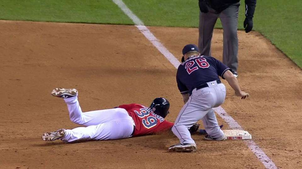 Santana safe on pickoff in 5th