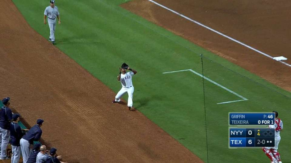 Beltre makes grab in foul ground