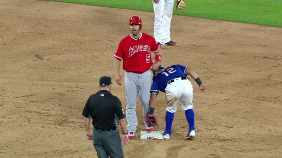 Pujols out after challenge