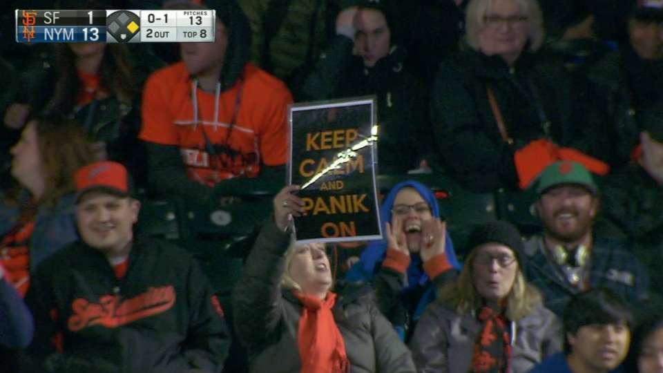 Giants fan brings sign, props