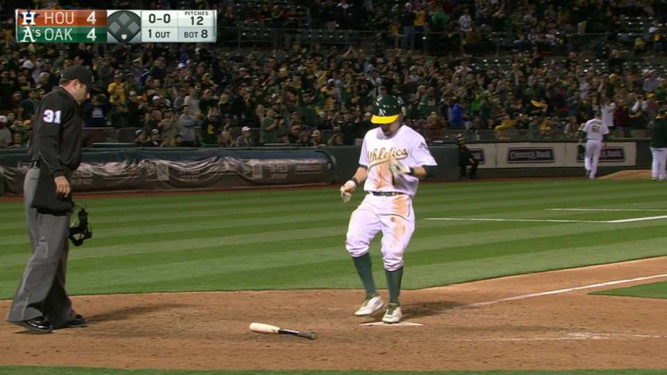 Lowrie's sac fly ties the game